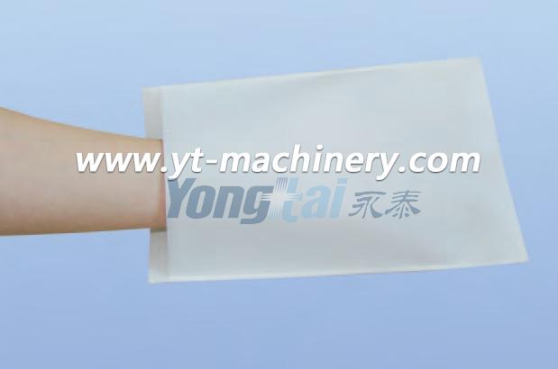 Machine de fabrication de gants non tissés